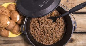 Delicious easy Dutch oven sloppy joes and a plate of slider buns to put them on.