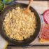Easy Dutch Oven Breakfast Burritos served with onion, cilantro, jalapano and salsa for garnish.