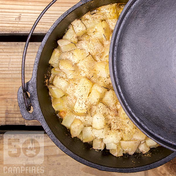 Yukon Gold potatoes layered on top of pork chops give Dutch Oven Pork Chops and Potatoes dish a great golden color with pork chops in creamy gravy on the bottom.