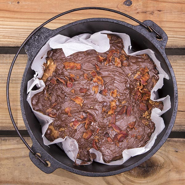 It may sound like a strange flavor combination, but these Dutch oven peanut butter, chocolate, and bacon bars are a smash hit for any camping trip.