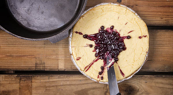 Cutting, serving, and clean up of Dutch oven cheese cake becomes amazingly easy when you use a pie tin inside the Dutch oven.