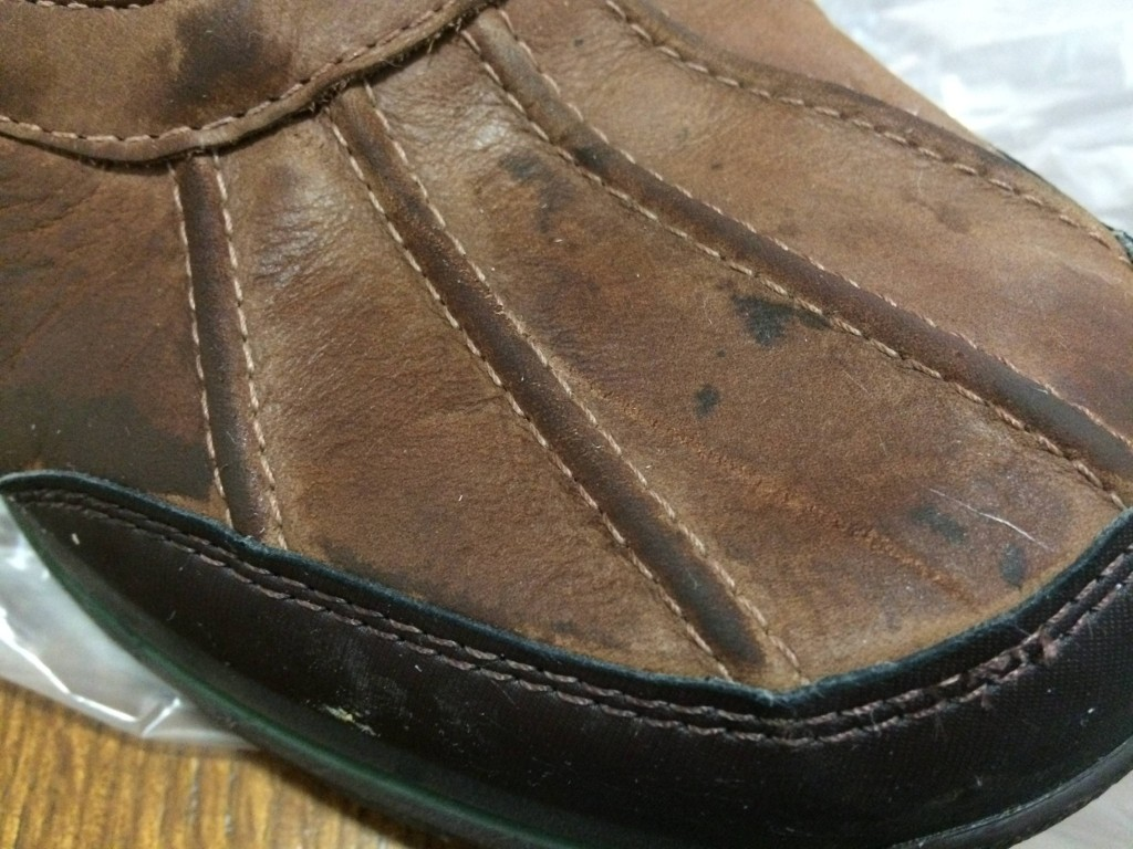 If your boots are dirty, you'll want to clean them before coating the dirt with wax.