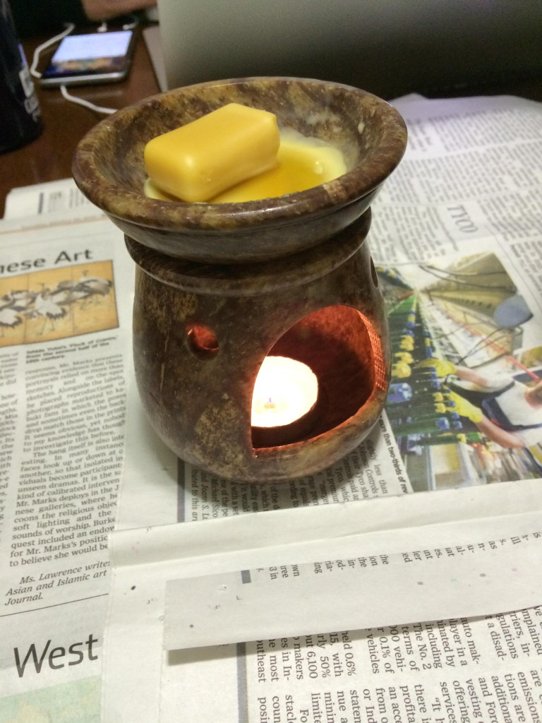 I melted the cosmetic grade beeswax with one of those scented oil lamps, and a little help from the heat gun because I'm impatient.