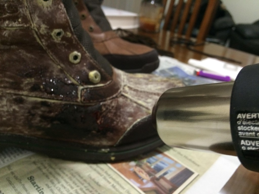 Use the heat gun to melt the wax, while using the toothbrush to smooth out the melting wax. It should absorb right into the boot. The toothbrush might melt a little, which is fine. Hold the heat gun just far enough to melt the wax without melting any synthetic parts of the boot, or burning any fur.