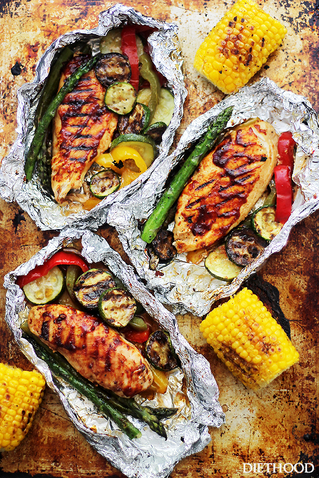 Grilled barbecue chicken and vegetables in foil source