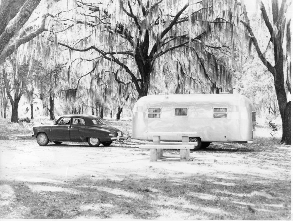 This photo shows a 1948 Studebaker and it is towing a large vintage Airstream created around the same time. This family seems to be enjoying their vacation in style somewhere south of the Mason-Dixon line.