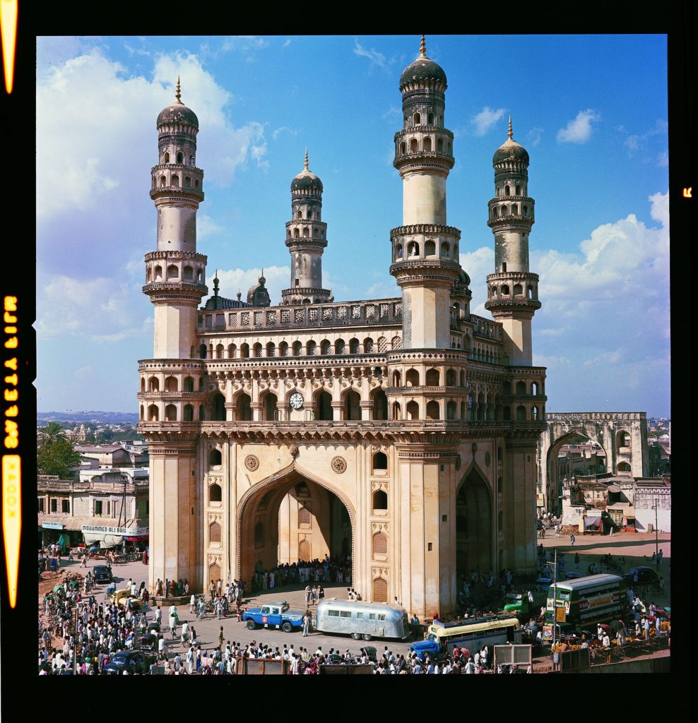 """In this photo, Charles' Ford pickup and Airstream are parked in front of the Charminar building in Hyderabad, India. Charminar means """"four towers"""" in the Urdu language."""