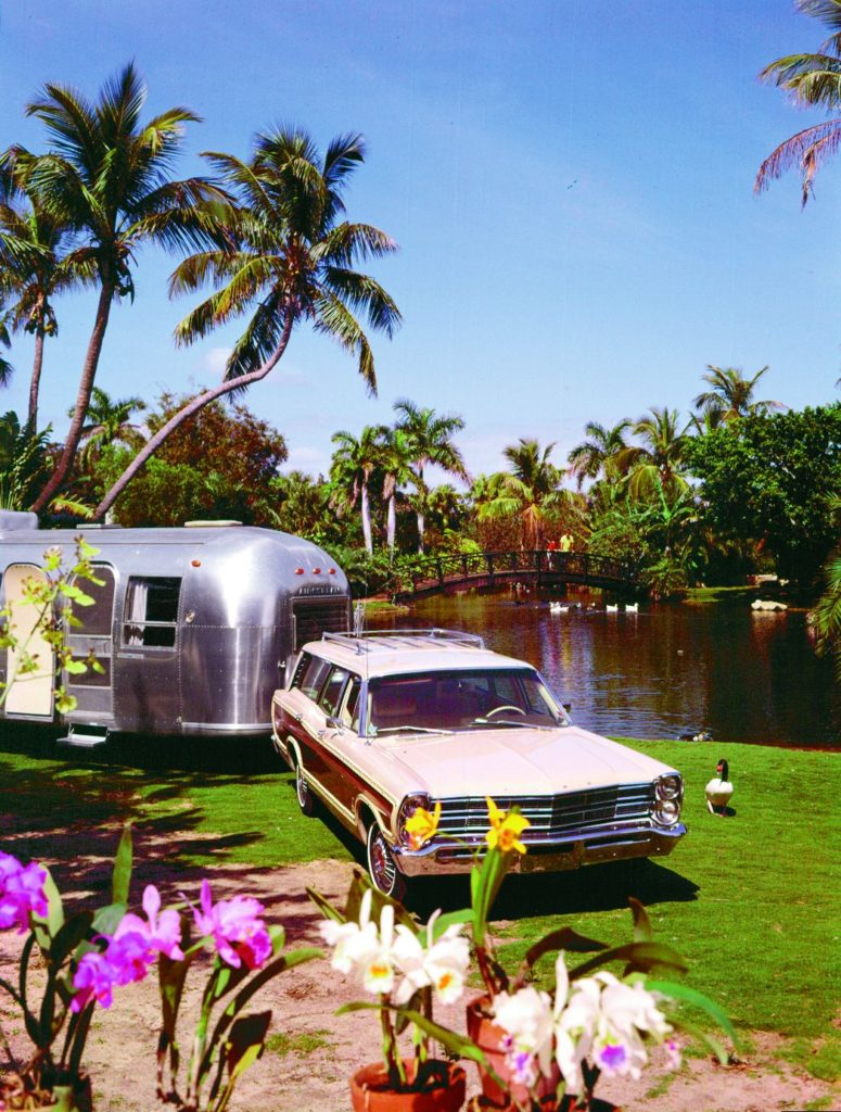 The Ford Country-Squire station wagon was an ideal vehicle for towing Airstream trailers in the 1960s and 1970s. This 1967 model is towing an Airstream through Hawaii.