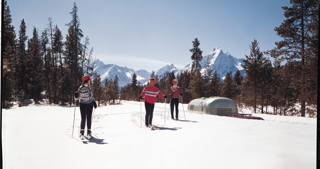 To make cold weather touring possible, the Airstream trailer offers extra-snug insulation and a great heating system. This couple took their Airstream to the mountains for a ski trip.