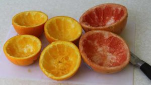 Citrus rinds ready for filling to make campfire birthday cake cupcakes in citrus halves.
