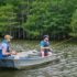 In a row boat on Chicot Lake in Arkansas fishing for catfish.