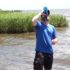 Clint drinks Mississippi River water from a LifeStraw GO Bottle during 50 Campfires Field Trip: Great River Road.