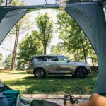 When the forecast is for rain, the 50 Campfires Team keeps the Field Trip: Great River Road Nissan Armada parked close and handy to the tent.