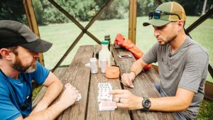 Nick and Clint playing Four Card Golf inside a Quick-Set Escape Shelter by Clam.