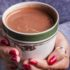 Warming hands on mug of Red Wine Hot Chocolate - The Perfect Camping Cocoa, made with Black Box Cabernet Sauvignon.