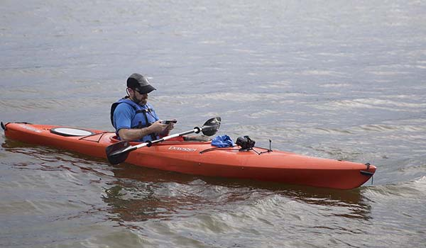 Clint texts -- without risking his phone -- from aboard a rented kayak.
