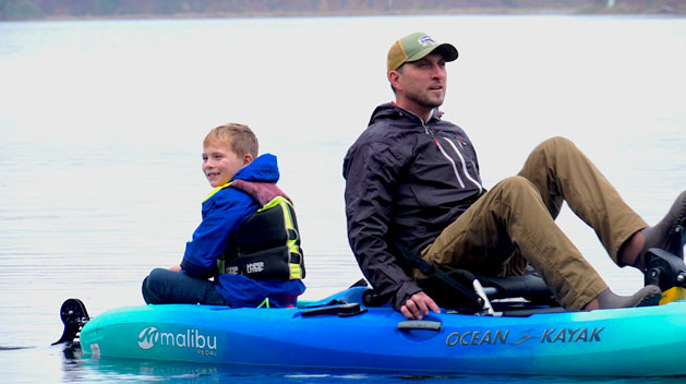 The Last Of The Open Water Young Son Enjoys Fall Kayak Trip