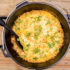 A beautiful, bubbly Dutch Oven Casserole made with prickly pear cactus pads called napoles.