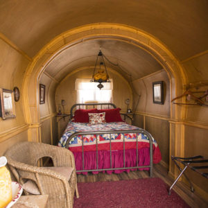 """""""Cute"""" interior of covered wagon at Airbnb Sandy Valley Ranch in Nevada, close to Las Vegas."""