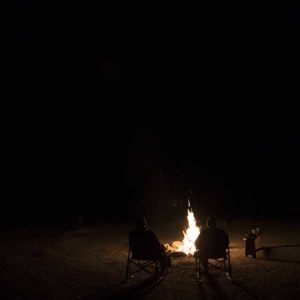 Desert nights are so dark, you literally can't see your hand in front of your face. A big campfire is a very welcome companion.