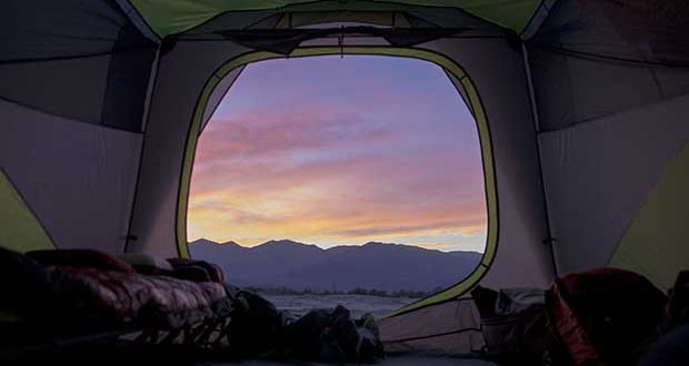 Desert sunsets viewed through the tent fly are worth putting up with the sand, searching for water, and avoiding scorpions.