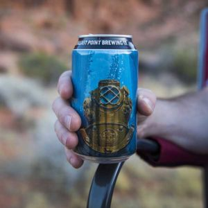 Close up of a can of Fathom IPA in Nick's hand.