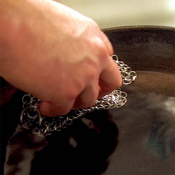 For truly stubborn residue break out the chain mail scrubber to clean, care for cast iron Dutch oven or skillet.
