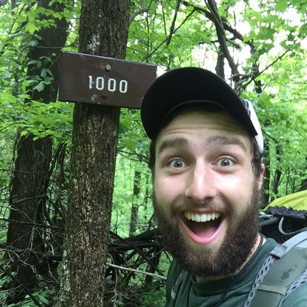 Owen Rachampbell of Darn Tough hits the 1000 mile mark on the Appalachian Trail.