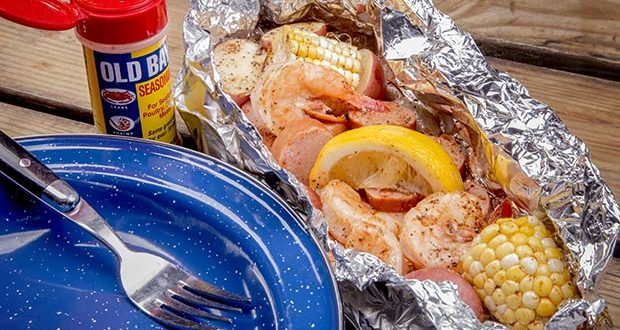 Campfire Shrimp Boil ingredients included in the foil packet are: shrimp, potatoes, sweet corn, sausage, and Old Bay Seasoning.