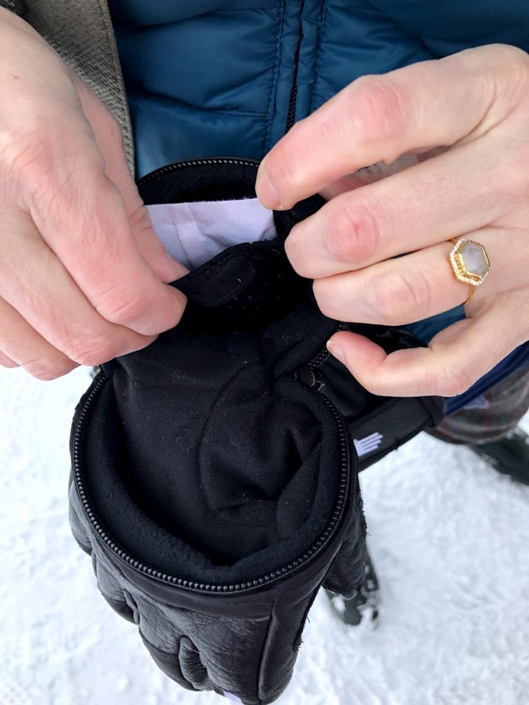 hand out gloves with hand warmer pocket