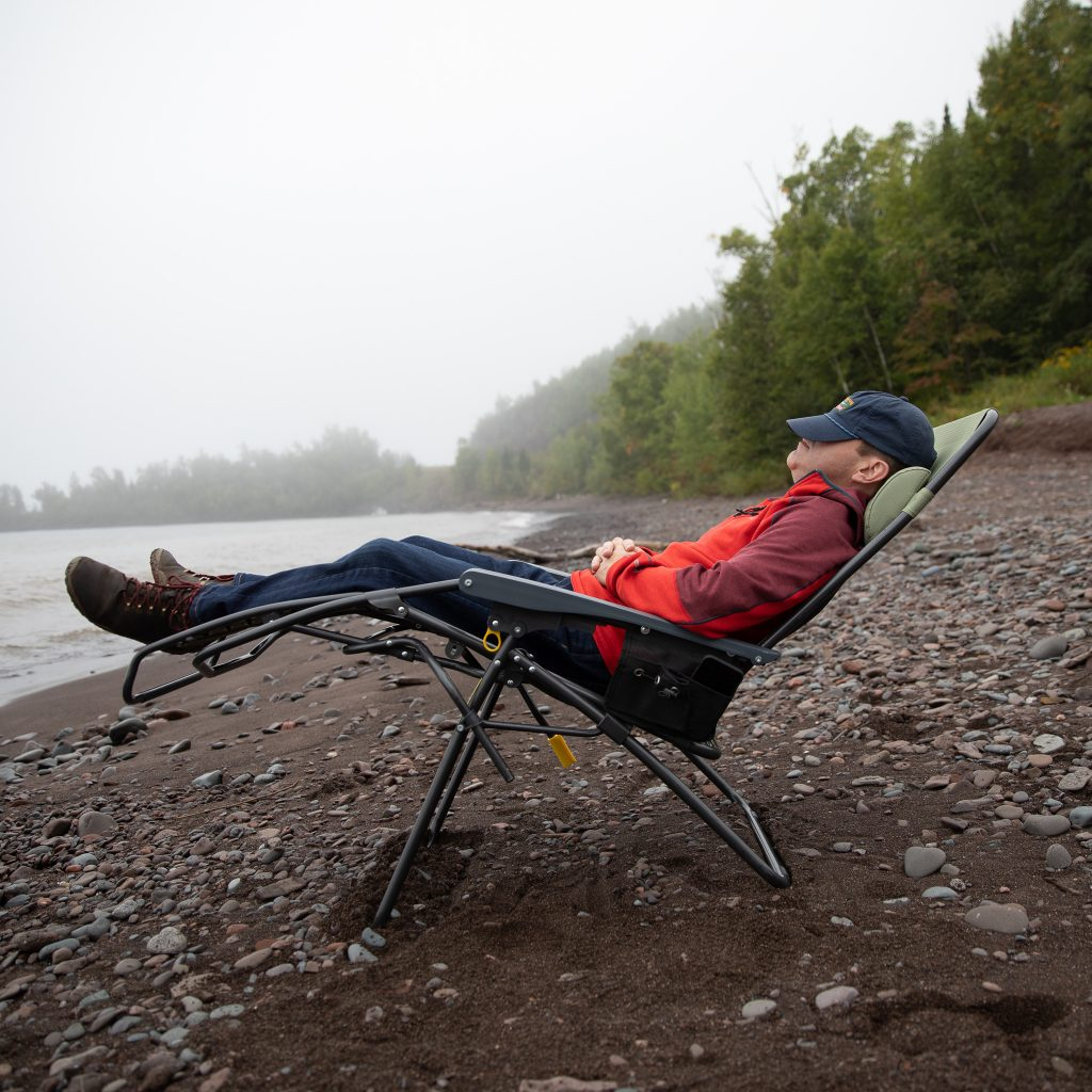 person sleeping in camping chair