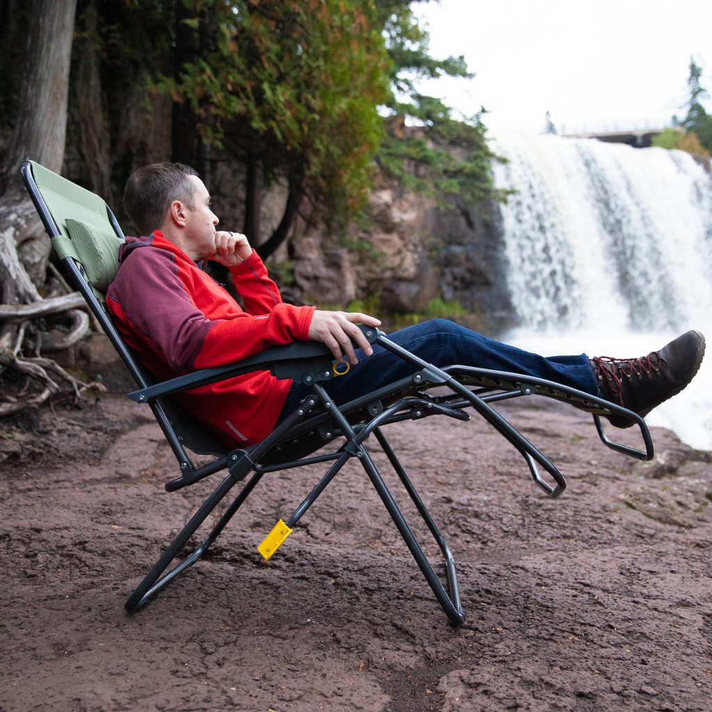 person sitting in camping chair