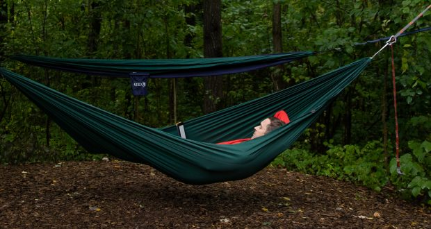 person laying in a hammock