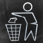 man throwing garbage away